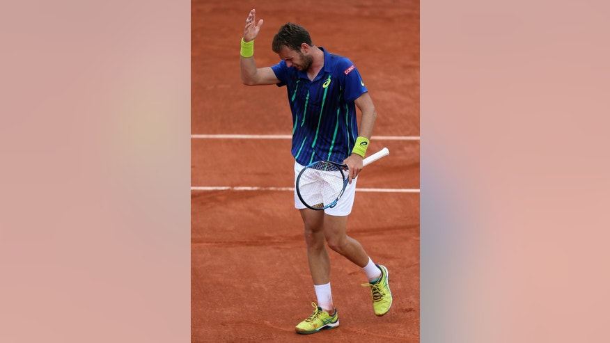France's Mathias Bourgue gestures as he plays Britain's Andy Murray during their second round match of the French Open tennis tournament at the Roland Garros stadium, Wednesday, May 25, 2016 in Paris.  (AP Photo/David Vincent)