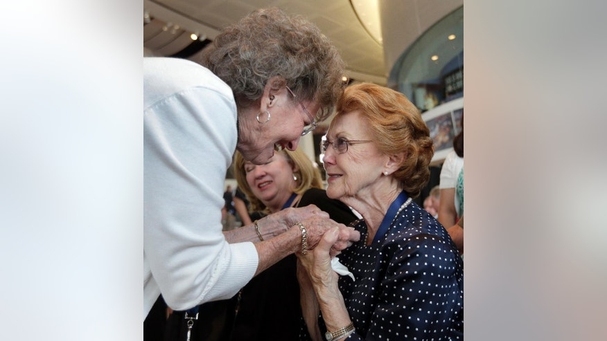 Violet Parks, right, is congratulated by Frances Flock, left, after Parks' husband, Raymond Parks, was announced as one of five inductees for the 2017 class of the NASCAR Hall of Fame in Charlotte, N.C., Wednesday, May 25, 2016. Flock is the widow of NASCAR Hall of Fame member Tim Flock. (AP Photo/Chuck Burton)