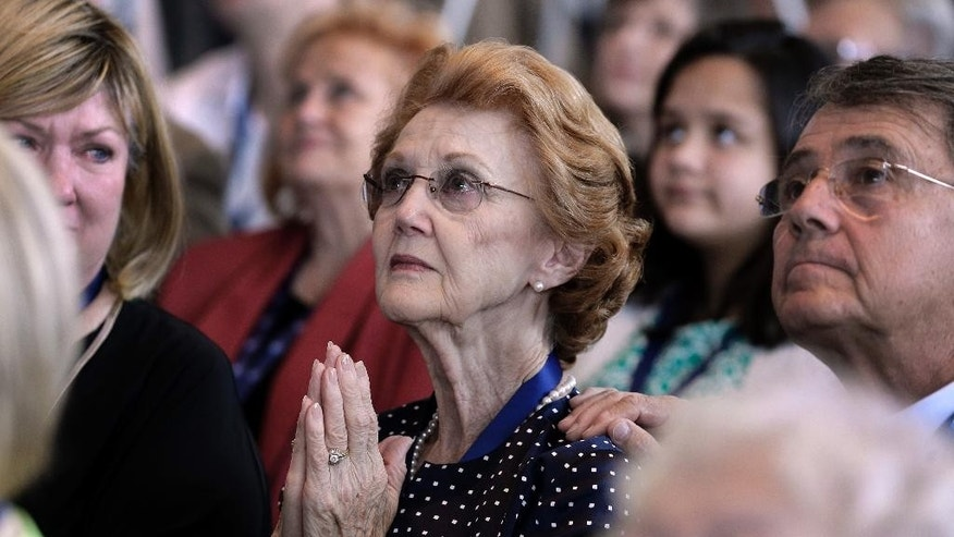 Violet Parks, center, watches a video after her husband, Raymond Parks, was announced as one of five inductees for the 2017 class of the NASCAR Hall of Fame in Charlotte, N.C., Wednesday, May 25, 2016. (AP Photo/Chuck Burton)
