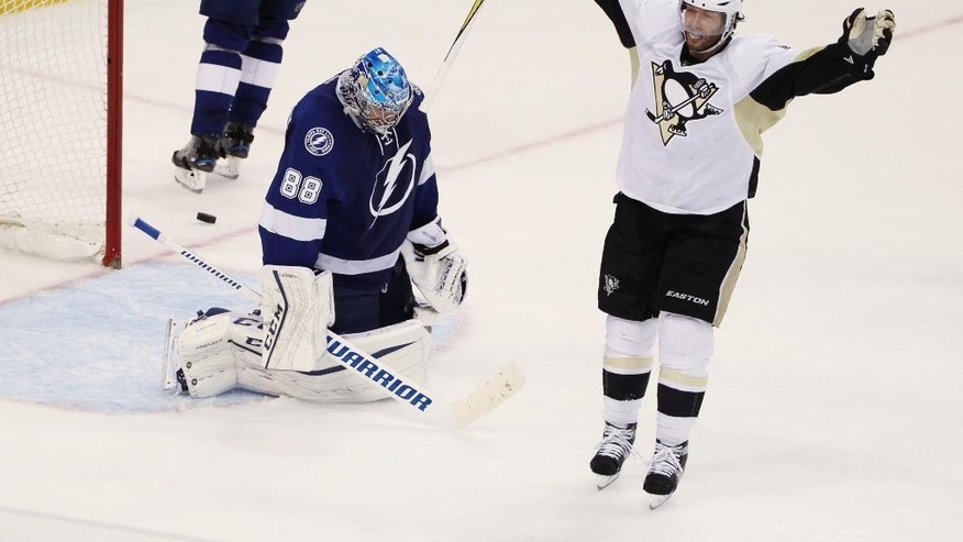 May 24, 2016: Pittsburgh Penguins center Matt Cullen (7) celebrates a goal by teammate Sidney Crosby (87), as Tampa Bay Lightning goalie Andrei Vasilevskiy (88) remains kneeling on the ice during the second period of Game 6 of the NHL Eastern Conference finals in Tampa, Fla.