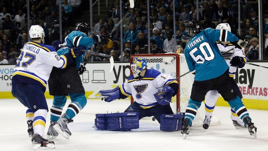San Jose Sharks' Joel Ward, second from left, scores past St. Louis Blues goalie Brian Elliott (1) during the second period in Game 6 of the NHL hockey Stanley Cup Western Conference finals Wednesday, May 25, 2016, in San Jose, Calif. (AP Photo/Marcio Jose Sanchez)