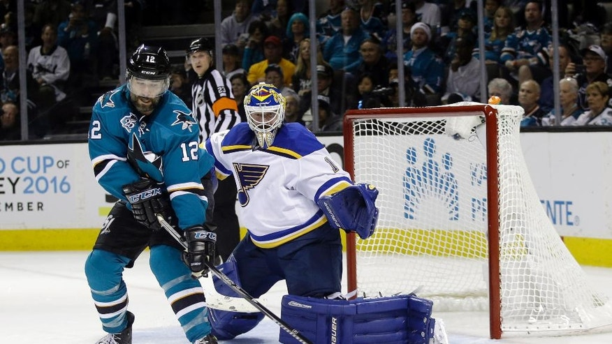 San Jose Sharks' Patrick Marleau (12) reaches for the puck next to St. Louis Blues goalie Brian Elliott (1) during the second period in Game 6 of the NHL hockey Stanley Cup Western Conference finals Wednesday, May 25, 2016, in San Jose, Calif. (AP Photo/Marcio Jose Sanchez)