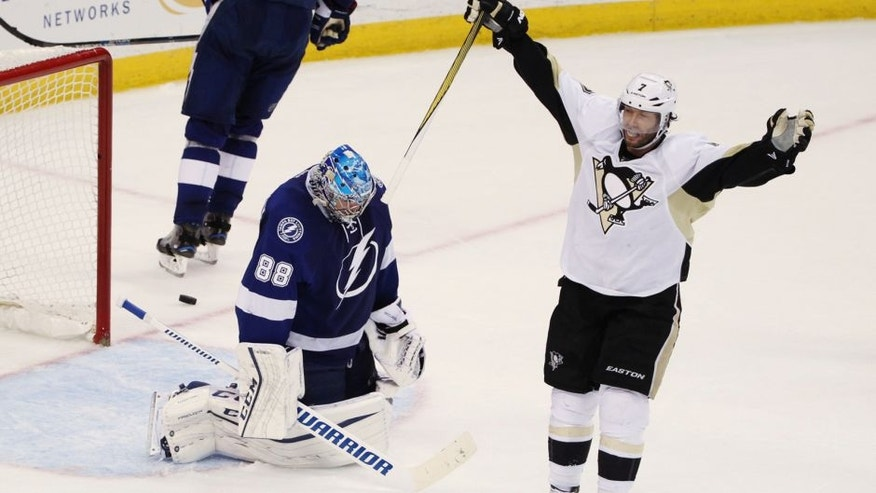 Pittsburgh Penguins center Matt Cullen (7) celebrates a goal by teammate Sidney Crosby (87), as Tampa Bay Lightning goalie Andrei Vasilevskiy (88), of Russia, remains kneeling on the ice, during the second period of Game 6 of the NHL hockey Stanley Cup Eastern Conference finals Tuesday, May 24, 2016, in Tampa, Fla. (AP Photo/Brian Blanco)