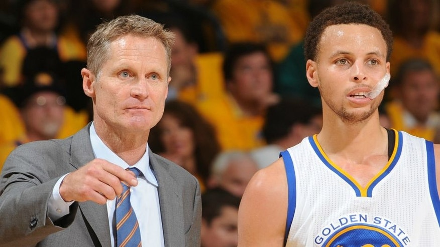 <p>OAKLAND, CA - MAY 27: Steve Kerr and Stephen Curry #30 of the Golden State Warriors speak during a game against the Houston Rockets in Game Five of the Western Conference Finals of the 2015 NBA Playoffs on May 27, 2015 at Oracle Arena in Oakland, California. NOTE TO USER: User expressly acknowledges and agrees that, by downloading and or using this photograph, user is consenting to the terms and conditions of Getty Images License Agreement. Mandatory Copyright Notice: Copyright 2015 NBAE (Photo by Noah Graham/NBAE via Getty Images)</p>