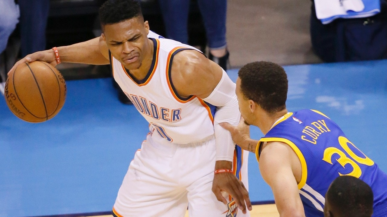 Oklahoma City Thunder guard Russell Westbrook (0) is defended by Golden State Warriors guard Stephen Curry (30) during the first half in Game 4 of the NBA basketball Western Conference finals in Oklahoma City, Tuesday, May 24, 2016. (AP Photo/Sue Ogrocki)