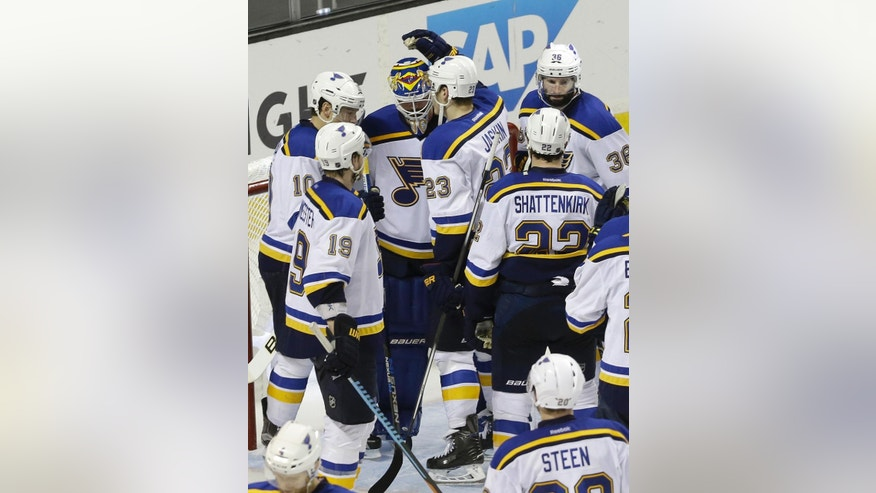 St. Louis Blues players gather around goalie Brian Elliott, top center, after the Blues lost to the San Jose Sharks in Game 6 of the NHL hockey Stanley Cup Western Conference finals in San Jose, Calif., Wednesday, May 25, 2016. The Sharks won 5-2. (AP Photo/Jeff Chiu)