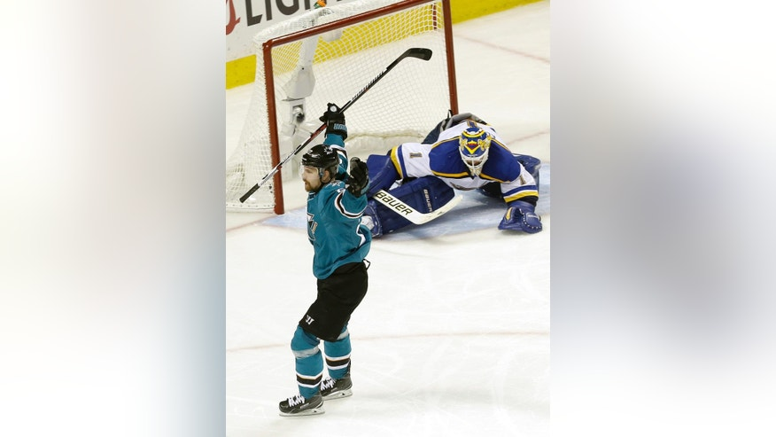 San Jose Sharks right wing Joonas Donskoi, foreground, from Finland, celebrates after scoring a goal against St. Louis Blues goalie Brian Elliott, rear, during the third period in Game 6 of the NHL hockey Stanley Cup Western Conference finals in San Jose, Calif., Wednesday, May 25, 2016. The Sharks won 5-2. (AP Photo/Jeff Chiu)