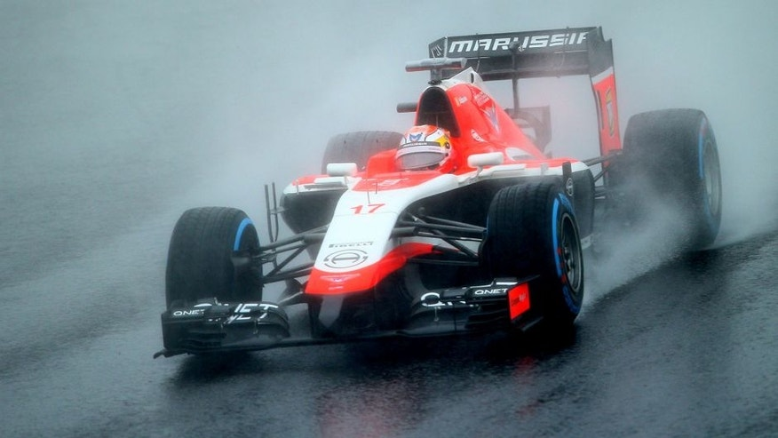 SUZUKA, JAPAN - OCTOBER 05: Jules Bianchi of France and Marussia drives during the Japanese Formula One Grand Prix at Suzuka Circuit on October 5, 2014 in Suzuka, Japan. (Photo by Mark Thompson/Getty Images)
