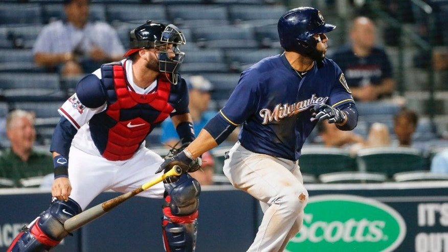 Milwaukee Brewers' Jonathan Villar drives in the go-ahead run with a base hit as Atlanta Braves catcher A.J. Pierzynski watches.