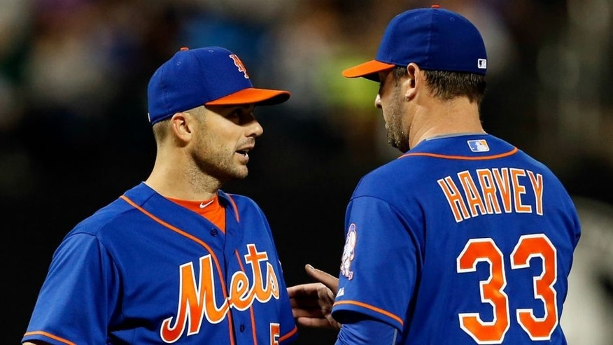 NEW YORK, NY - SEPTEMBER 20: Matt Harvey #33 of the New York Mets talks with David Wright #5 of the New York Mets against the New York Yankees at Citi Field on September 20, 2015 in the Queens borough of New York City. (Photo by Adam Hunger/Getty Images)