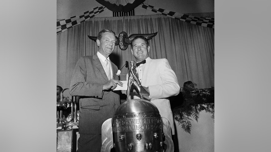"FILE - In this May 31, 1962, file photo, Tony Hulman, left, owner of the Indianapolis Speedway, poses with Rodger Ward, winner of that year's Indianapolis 500 auto race, the purse for winning, and the winner's trophy, the day after the race at a victory dinner in Indianapolis. In the lead-up to the 100th running of the ""The Greatest Spectacle in Racing,"" The Associated Press interviewed the 27 living race winners on topics ranging from the best driver to greatest tradition.  When asked for the most important non-driver to the Indianapolis 500, Hulman edged team owner Roger Penske in voting among the living winners. (AP Photo/File)"