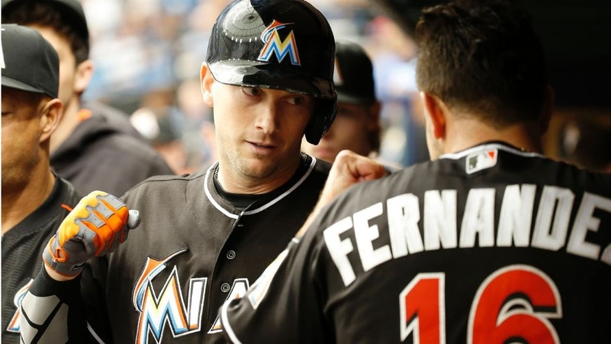 <p>May 26, 2016; St. Petersburg, FL, USA; Miami Marlins first baseman Chris Johnson (12) is congratulated by starting pitcher Jose Fernandez (16) in the dugout after he hit a 2-run home run during the third inning against the Tampa Bay Rays at Tropicana Field. Mandatory Credit: Kim Klement-USA TODAY Sports</p>