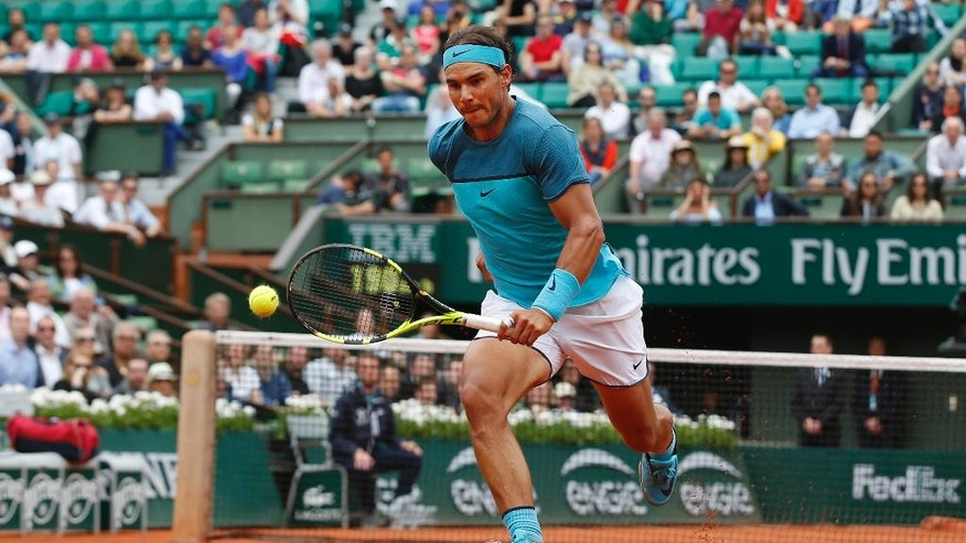 Spain's Rafael Nadal runs to return a shot in his second round match of the French Open tennis tournament against Argentina's Facundo Bagnis at the Roland Garros stadium in Paris, France, Thursday, May 26, 2016. (AP Photo/Alastair Grant)