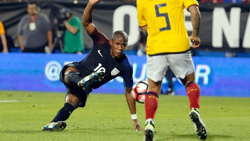 CORRECTS TO DARLINGTON NAGBE, INSTEAD OF NAGBE DARLINGTON - U.S. midfielder Darlington Nagbe takes a shot and scores in front of Ecuador's Christian Ramirez (5) during the second half of an exhibition soccer match, Wednesday, May 25, 2016, in Frisco, Texas. The United States won 1-0. (AP Photo/Tony Gutierrez)