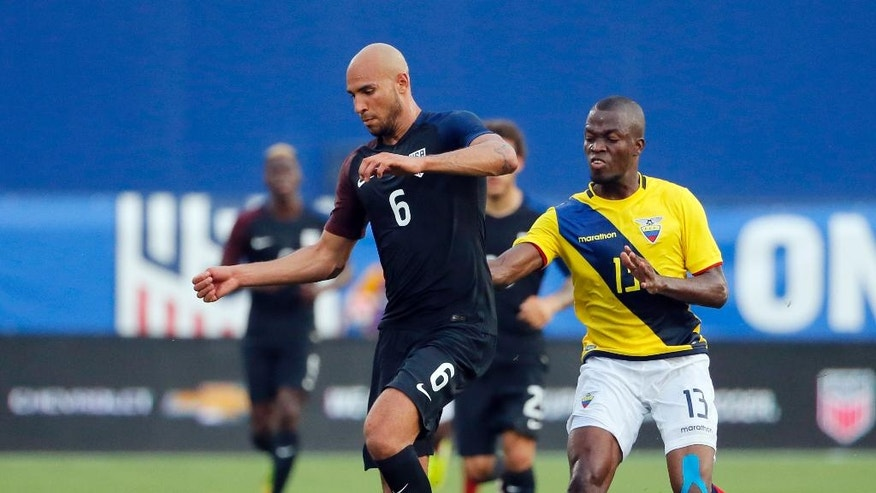 U.S. defender John Brooks (6) controls the ball as Ecuador midfielder Enner Valencia pressures during the first half of an exhibition soccer match, Wednesday, May 25, 2016, in Frisco, Texas. (AP Photo/Tony Gutierrez)