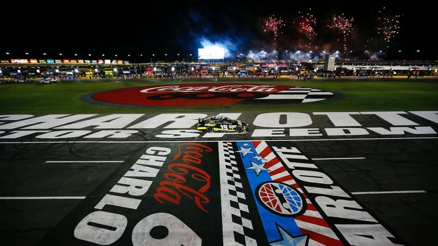 Carl Edwards, driver of the #19 Subway Toyota, celebrates with a burnout after winning during the NASCAR Sprint Cup Series Coca-Cola 600 at Charlotte Motor Speedway on May 24, 2015 in Charlotte, North Carolina.