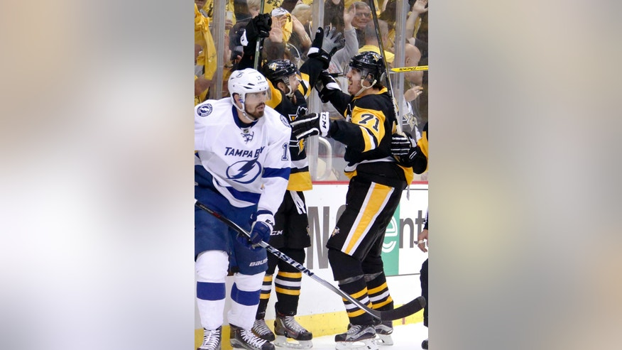 Pittsburgh Penguins' Bryan Rust, center, celebrates with teammate Evgeni Malkin (71) after scoring as Tampa Bay Lightning's Alex Killorn (17) skates away during the second period of Game 7 of the NHL hockey Stanley Cup Eastern Conference finals, Thursday, May 26, 2016, in Pittsburgh. (AP Photo/Gene J. Puskar)