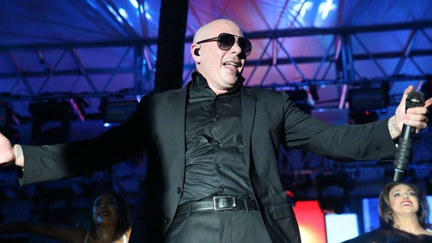 MIAMI, FL - MARCH 05: Pitbull attends Destination Fashion 2016 to benefit The Buoniconti Fund to Cure Paralysis, the fundraising arm of The Miami Project to Cure Paralysis at Bal Harbour Shops on March 5, 2016 in Miami, Florida. (Photo by Aaron Davidson/FilmMagic)