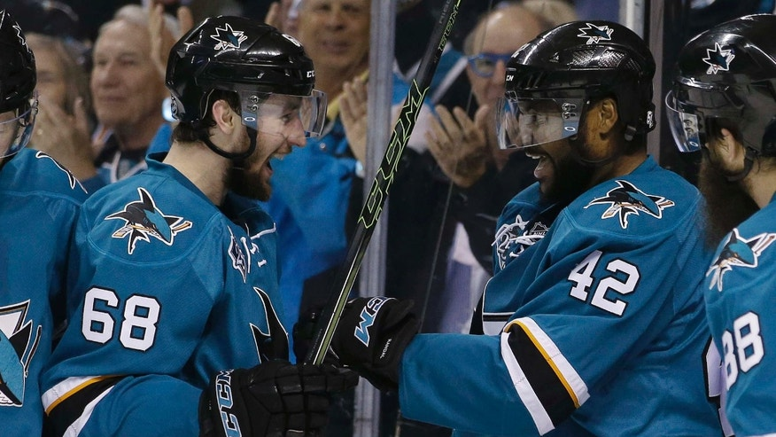 May 25, 2016: San Jose Sharks' Joel Ward (42) celebrates his goal with teammate Melker Karlsson (68) during the second period in Game 6 of the NHL hockey Stanley Cup Western Conference finals against the St. Louis Blues  in San Jose, Calif.