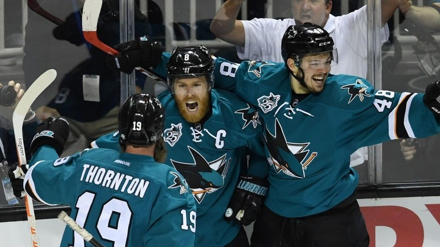 SAN JOSE, CA - MAY 25: Joe Pavelski #8 of the San Jose Sharks celebrates his goal against the St. Louis Blues with Joe Thornton #19 and Tomas Hertl #48 in Game Six of the Western Conference Final during the 2016 NHL Stanley Cup Playoffs at SAP Center on May 25, 2016 in San Jose, California. (Photo by Thearon W. Henderson/Getty Images)