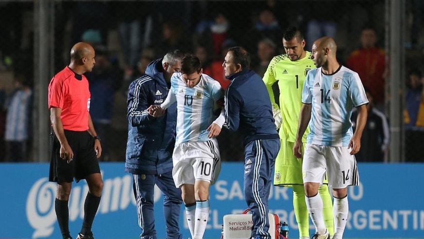 Argentina's Lionel Messi (10) is assisted off the field during a friendly soccer match in San Juan, Argentina, Friday, May 27, 2016. (AP Photo/Nicolas Aguilera)