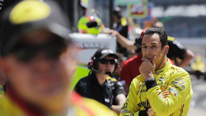 Helio Castroneves, of Brazil, watches during a practice session for the Indianapolis 500 auto race at Indianapolis Motor Speedway in Indianapolis, Monday, May 23, 2016. (AP Photo/Darron Cummings)