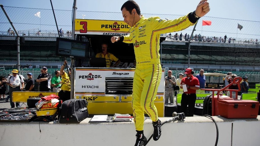 Helio Castroneves, of Brazil, jumps off the pit wall during a practice session for the Indianapolis 500 auto race at Indianapolis Motor Speedway in Indianapolis, Monday, May 23, 2016. (AP Photo/Darron Cummings)