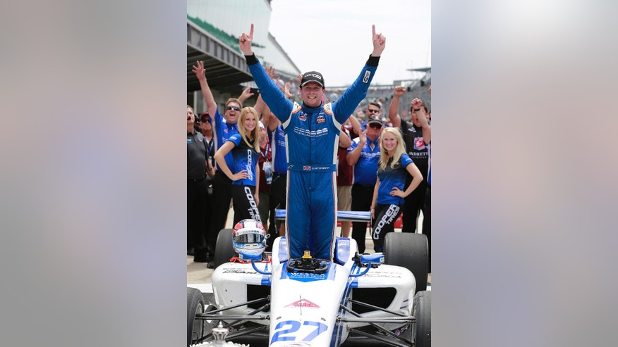Dean Stoneman, of England, celebrates after winning the Indy Lights Freedom 100 Race at Indianapolis Motor Speedway in Indianapolis, Friday, May 27, 2016. (AP Photo/R Brent Smith)