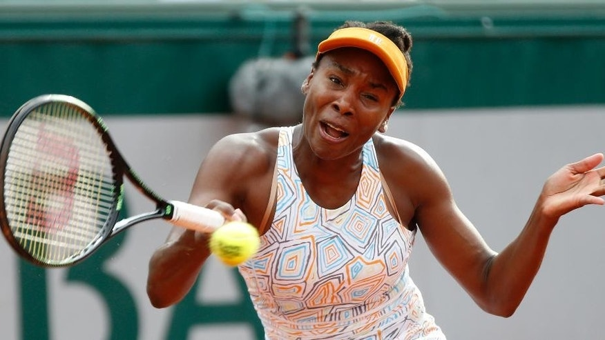 Venus Williams of the U.S. returns in her second round match of the French Open tennis tournament against Louisa Chirico of the U.S. at the Roland Garros stadium in Paris, France, Thursday, May 26, 2016. (AP Photo/Alastair Grant)