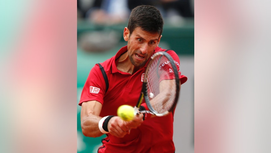 Serbia's Novak Djokovic returns the ball to Belgium's Steve Darcis during their second round match of the French Open tennis tournament at the Roland Garros stadium, Thursday, May 26, 2016 in Paris.  (AP Photo/Michel Euler)