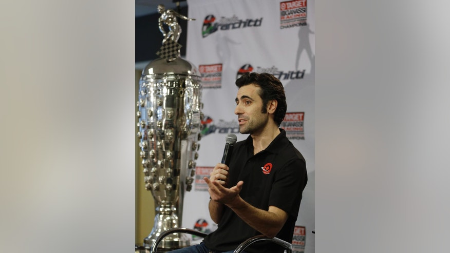 "FILE - In this Dec. 19, 2013, file photo, race driver Dario Franchitti, of Scotland, answers a question during his first public appearance since a crash ended his IndyCar career during a press conference in Indianapolis. Franchitti doesn't remember the crash that ended his career three years ago in Houston. What he does recall is that the first voice he heard afterward instantly put him at ease. ""Trammell is that you?"" Franchitti said, referring to IndyCar's safety consultant Dr. Terry Trammell.  (AP Photo/Michael Conroy, File)"