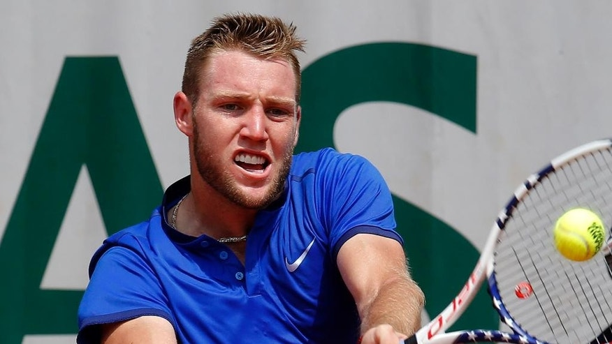 Jack Sock of the U.S. returns the ball to Spain's Albert Ramos-Vinolas during their third round match of the French Open tennis tournament at the Roland Garros stadium, Friday, May 27, 2016 in Paris.  (AP Photo/Michel Euler)