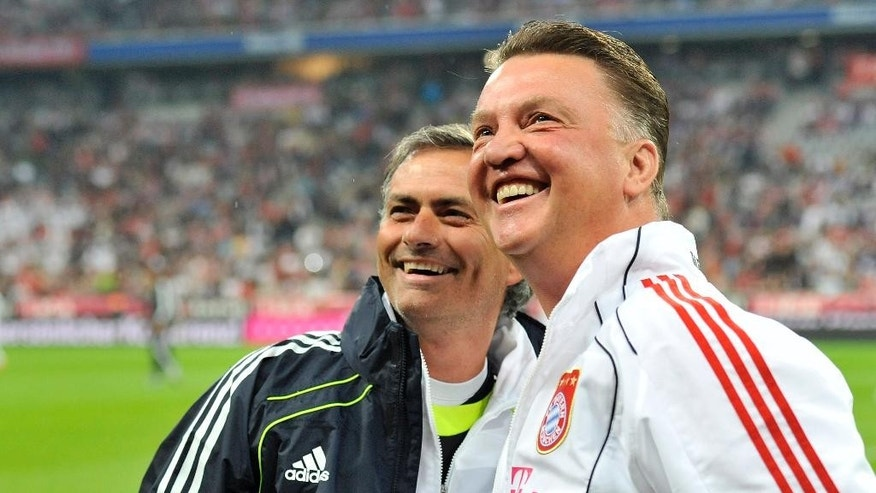 FILE - In this Friday, Aug. 13, 2010 file photo, Munich's head coach Louis van Gaal, right, and Madrid's head coach Jose Mourinho smile prior to the friendly soccer match between FC Bayern Munich and Real Madrid in Munich, southern Germany. Manchester United has fired manager Louis van Gaal after two turbulent years at the English Premier League club, it was reported on Monday, May 23, 2016. Former Chelsea manager Jose Mourinho is expected to replace Van Gaal.  (AP Photo/Kerstin Joensson, File)