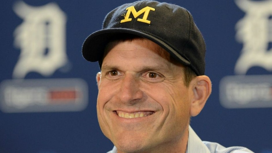 DETROIT, MI - JUNE 30: University of Michigan head football coach Jim Harbaugh looks on and smiles while talking to the media prior to the Major League Baseball game between the Pittsburgh Pirates and the Detroit Tigers at Comerica Park on June 30, 2015 in Detroit, Michigan. (Photo by Mark Cunningham/MLB Photos via Getty Images)
