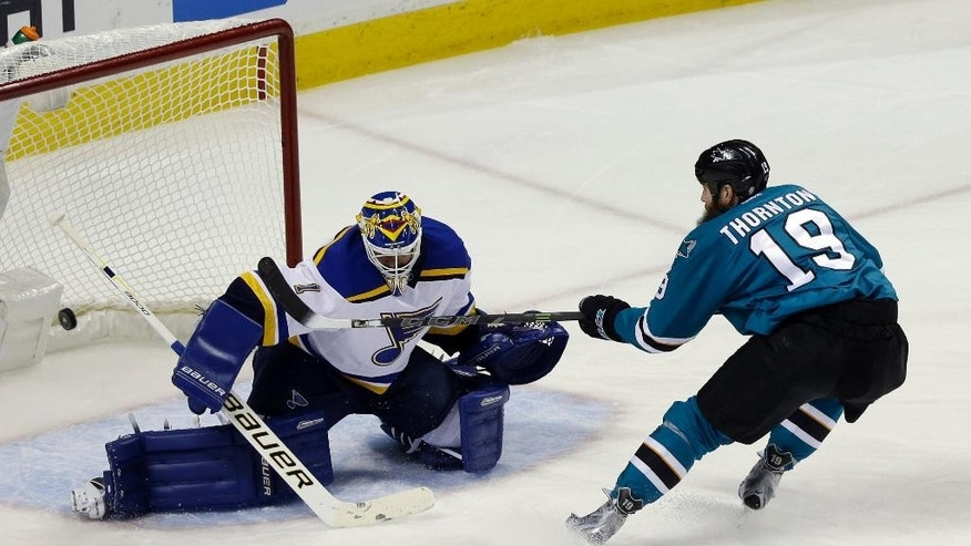 St. Louis Blues goalie Brian Elliott (1) deflects a shot from San Jose Sharks' Joe Thornton (19) during the first period in Game 6 of the NHL hockey Stanley Cup Western Conference finals Wednesday, May 25, 2016, in San Jose, Calif. (AP Photo/Jeff Chiu)