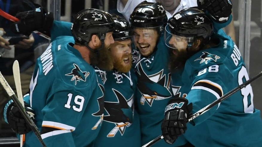 Joe Pavelski #8 of the San Jose Sharks celebrates his goal against the St. Louis Blues with Joe Thornton #19, Brent Burns #88 and Tomas Hertl #48 in Game Six of the Western Conference Final during the 2016 NHL Stanley Cup Playoffs at SAP Center on May 25, 2016 in San Jose, California. (Photo by Thearon W. Henderson/Getty Images)