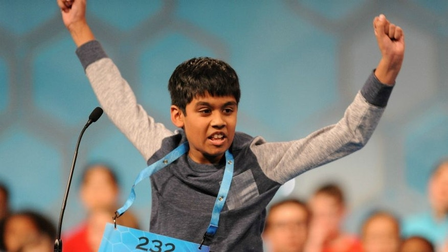 May 26, 2016; National Harbor, MD, USA; Nihar Janga, 11, of Austin, Texas, reacts after correctly spelling 'quillon' in the finals during the 2016 Scripps National Spelling Bee at the Gaylord National Resort and Convention Center. Mandatory Credit: Christopher Powers-USA TODAY NETWORK