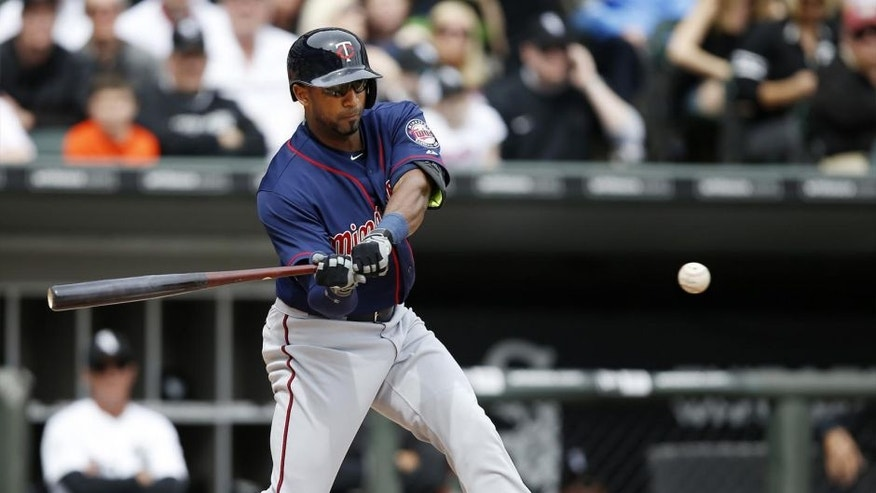 Sunday, April 12: Minnesota Twins left fielder Eduardo Nunez hits a double against the Chicago White Sox during the third inning. The Twins lost 6-2.