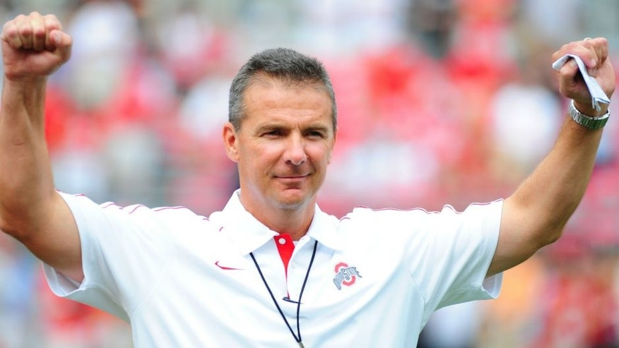 COLUMBUS, OHIO - SEPTEMBER 1, 2012: Head coach Urban Meyer of the Ohio State Buckeyes reacts to the chants of the fans before a game with the Miami Redhawks at Ohio Stadium in Columbus, Ohio. The Buckeyes won 56-10.(Photo by David Dermer/ Diamond Images/ Getty Images)