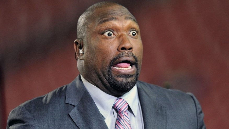Oct 24, 2013; Tampa, FL, USA; NFL former player Warren Sapp reacts on stage before a game between the Carolina Panthers and the Tampa Bay Buccaneers at Raymond James Stadium. Mandatory Credit: Steve Mitchell-USA TODAY Sports