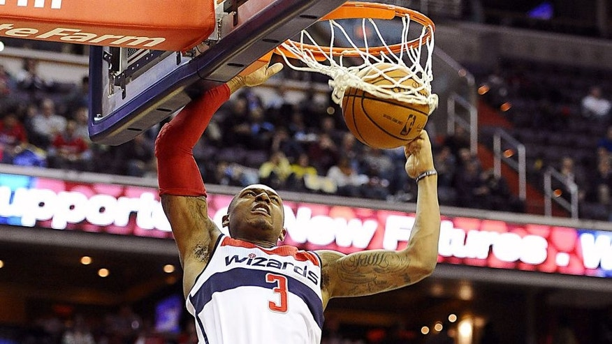 Mar 5, 2014; Washington, DC, USA; Washington Wizards shooting guard Bradley Beal (3) dunks the ball against the Utah Jazz during the second half at Verizon Center. The Wizards defeated the Jazz 104 - 91. Mandatory Credit: Brad Mills-USA TODAY Sports