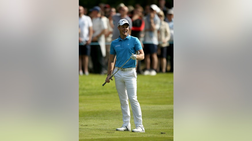 England's Masters champion Danny Willett reacts on the sixteenth hole during day three of the PGA Championship at Wentworth Club, Virginia Water, England, Saturday May 28, 2016. Willett made six birdies in a tournament-record 29 on the front nine on Friday. (Steve Paston / PA via AP) UNITED KINGDOM OUT - NO SALES - NO ARCHIVES