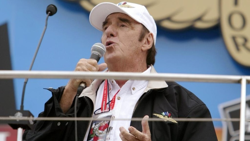 "FILE - In this May 30, 2004, file photo, Jim Nabors sings his annual rendition of ""Back Home Again in Indiana"" before the Indianapolis 500 at Indianapolis Motor Speedway, in Indianapolis. (AP Photo/Michael Conroy, File)"