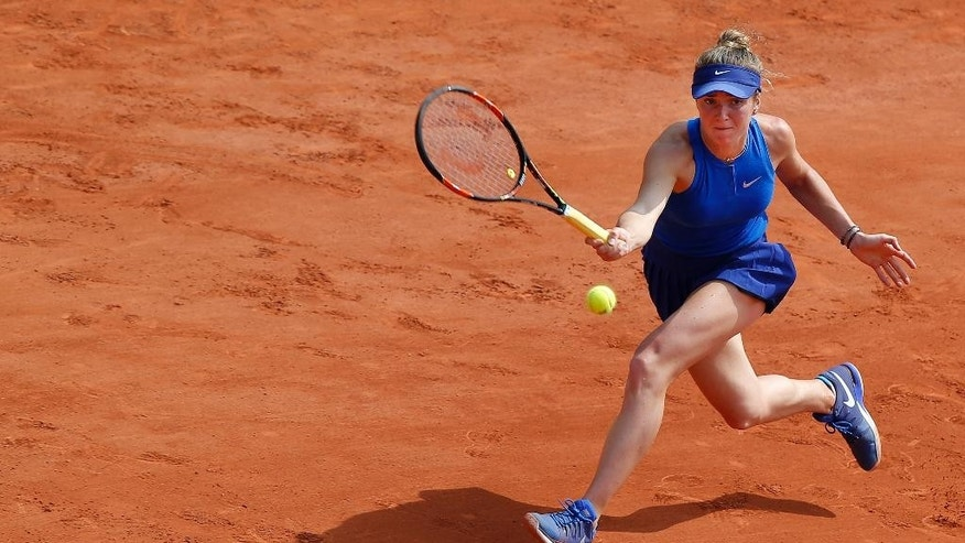 Ukraine's Elina Svitolina returns in the third round match of the French Open tennis tournament against Serbia's Ana Ivanovic at the Roland Garros stadium in Paris, France, Saturday, May 28, 2016. (AP Photo/Michel Euler)
