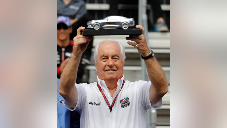 Pace car driver and car owner Roger Penske displays a model of the pace car that he will drive to start the race during the drivers meeting for the Indianapolis 500 auto race at Indianapolis Motor Speedway in Indianapolis, Saturday, May 28, 2016. (AP Photo/Jeff Roberson)