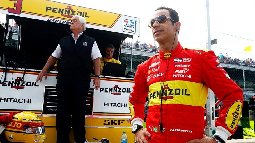 INDIANAPOLIS, IN - MAY 27: Helio Castroneves #3 of Brazil watches alongside owner Roger Penske during Carb Day ahead of the 100th running of the Indianapolis 500 at Indianapolis Motorspeedway on May 27, 2016 in Indianapolis, Indiana. (Photo by Jamie Squire/Getty Images)