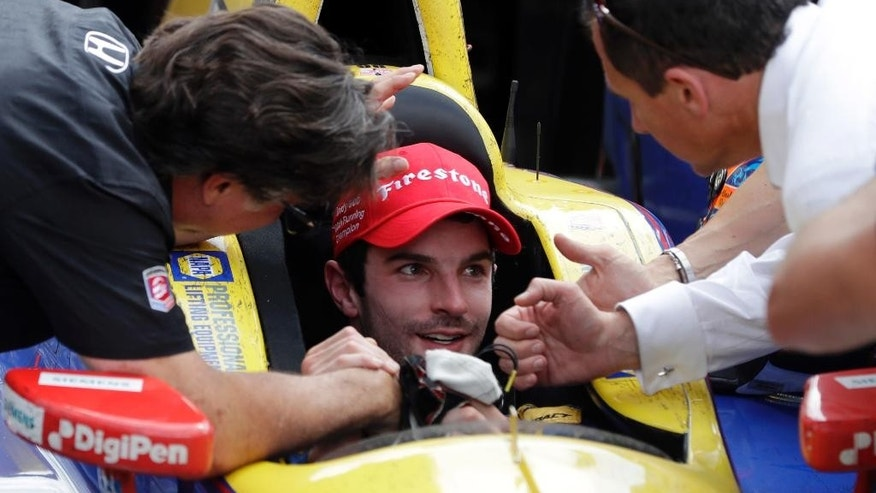 Alexander Rossi, center, celebrates with car owner Michael Andretti, left, after winning the 100th running of the Indianapolis 500 auto race at Indianapolis Motor Speedway in Indianapolis, Sunday, May 29, 2016. (AP Photo/Darron Cummings)