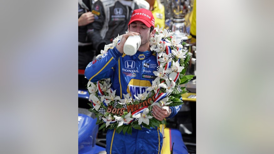 Alexander Rossi celebrates after winning the 100th running of the Indianapolis 500 auto race at Indianapolis Motor Speedway in Indianapolis, Sunday, May 29, 2016. (AP Photo/Michael Conroy)