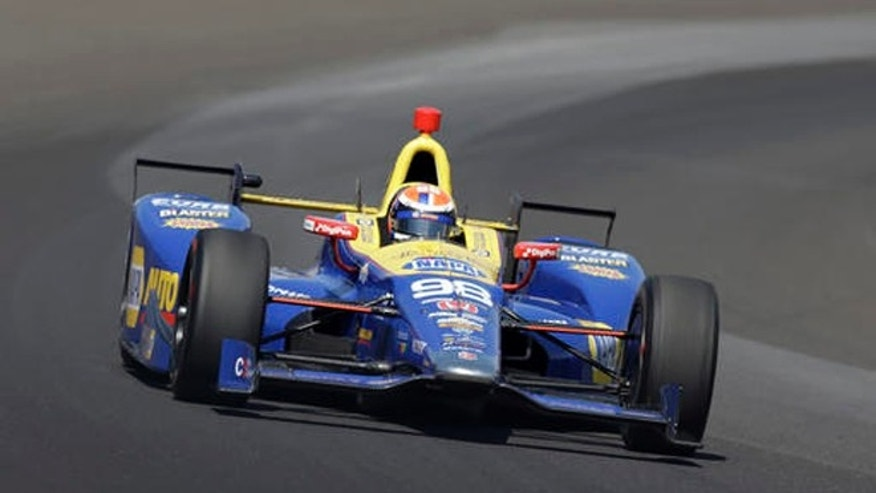 Alexander Rossi drives through turn one during the final practice session for the Indianapolis 500 auto race at Indianapolis Motor Speedway in Indianapolis, Friday, May 27, 2016. (AP Photo/Michael Conroy)