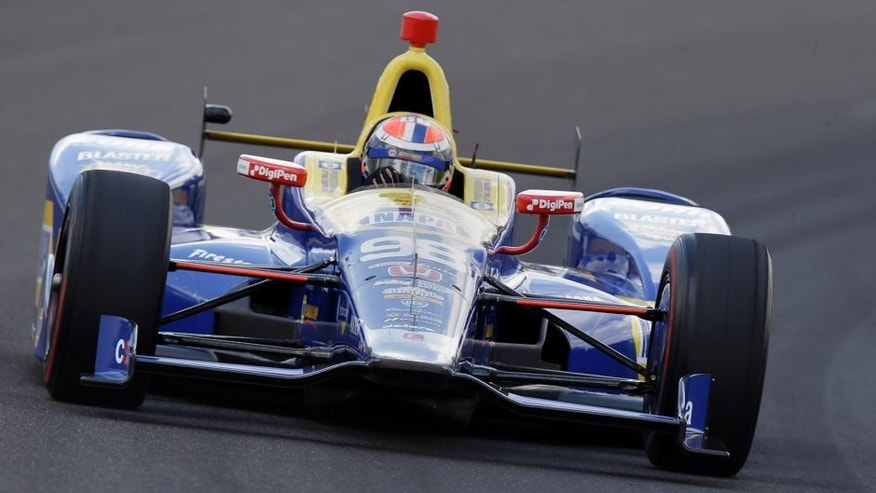 Alexander Rossi drives the the first turn during a practice session on the opening day of qualifications for the Indianapolis 500 auto race at Indianapolis Motor Speedway in Indianapolis, Saturday, May 21, 2016. (AP Photo/Michael Conroy)